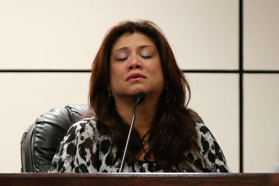 Melissa Gomez reacts as she testifies for the state on the first day of George Munoz, Jr., trial in the Bexar County 226th Criminal District Court before Judge Sid Harle, Tuesday, June 30, 2015. Munoz is facing four counts of murder stemming from a 2013 Father's Day wreck that killed four members of the Lindsey family. Prosecution contents that Munoz was fleeing police when he wreck into the Lindsay family car in the 3800 block of Culebra Road. Wesley Lindsay, 27, Kathy Castillo, 25; and two of the couple's three sons -- Edward Lindsay, 7 and Davon Lindsay, 3, -- died in the crash that was so forceful it caused the car to catch fire. Photo: JERRY LARA, Staff / San Antonio Express-News / © 2015 San Antonio Express-News