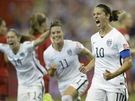 United States' Carli Lloyd (10) celebrates with teammates Ali Krieger (11) and Morgan Brian after scoring on a penalty kick against Germany during the second half of a semifinal in the Women's World Cup soccer tournament, Tuesday, June 30, 2015, in Montreal, Canada. (Ryan Remiorz/The Canadian Press via AP)