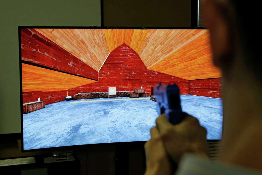 Baron Giuffria, who is developing a video game that allows betting, plays a prototype in Las Vegas.  Photo: John Locher, STF / AP