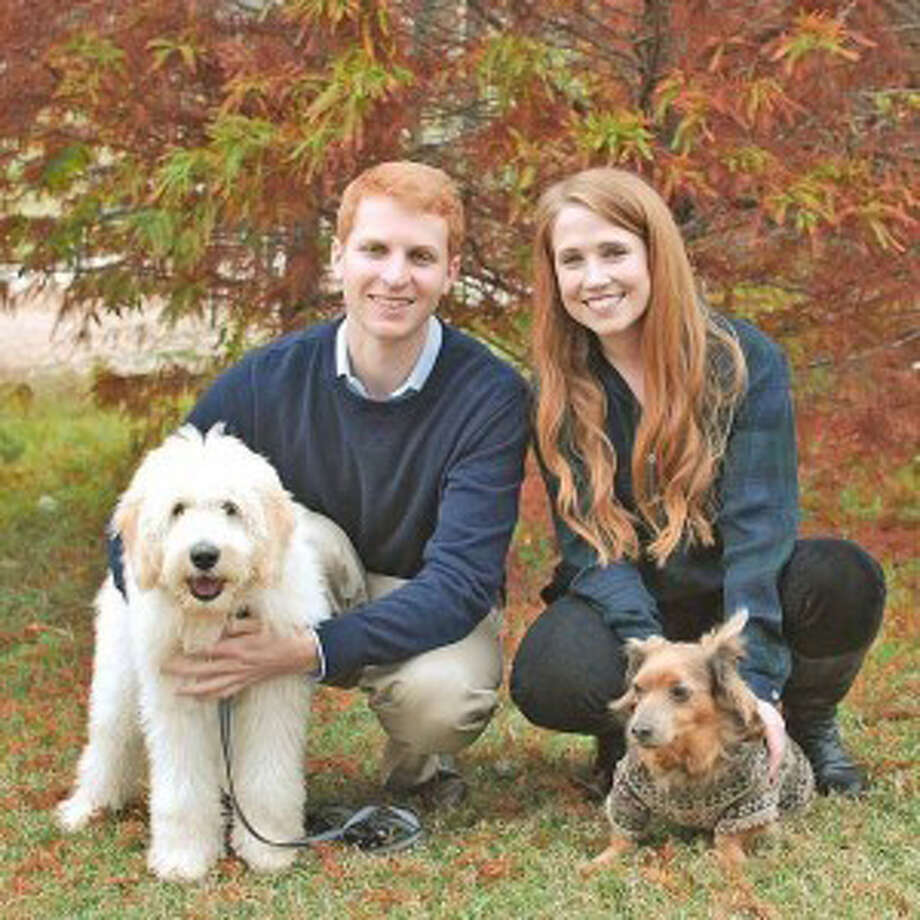 Allie Gutshall, right, who lives in Houston, poses with her boyfriend and two dogs. Gutshall says Benlysta, the drug she takes for lupus has been a miracle drug for her. Photo: HANDOUT, Washington Post / The Washington Post