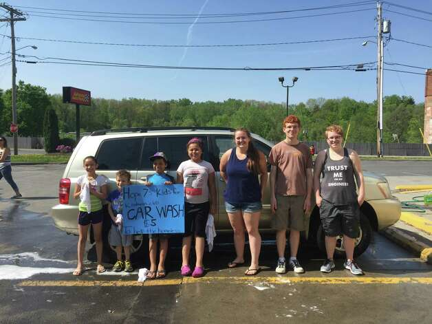 "Hope 7's ""Kids for Kindness Club"" presented a car wash to raise money to purchase blankets for a local homeless shelter. Assisting were the RPI Circle K Fraternity, Advance Auto Parts and Perrotta's Bakery. The effort raised $461. (Submitted photo)"