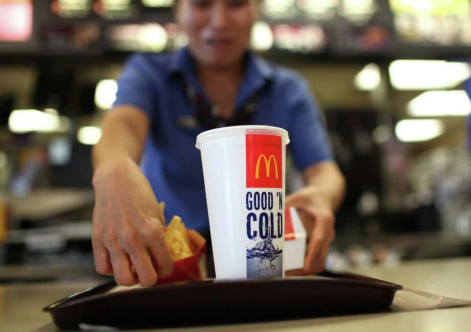 Managers often pitch in on the front lines of retail and fast-food establishments, working way beyond 40 hours a week. Without overtime pay, some experts say, their hourly wage often ends less than the minimum of $7.25 an hour. Photo: Getty Images File Photo / 2011 Getty Images