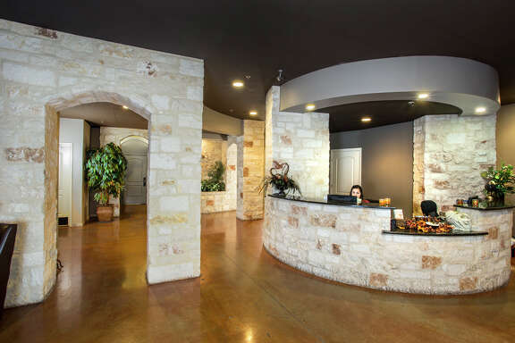 The reception room at San Antonio's Spa D'Sante locations is designed with granite and stone walls and counters for an old world feel, said owner Esther Rodriguez-Nail. Spa D'Sante is this year's Reader's Choice Gold winner.