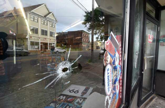 A bullet hole in the window of the Zaid Food Mart at 807 Albany Street early Tuesday morning June 30, 2015 after a murder in Schenectady, N.Y.  (Skip Dickstein/Times Union) Photo: SKIP DICKSTEIN