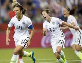United States' Carli Lloyd (10) reacts after scoring on a penalty kick against Germany as Meghan Klingenberg (22) follows during the second half of a semifinal in the Women's World Cup soccer tournament, Tuesday, June 30, 2015, in Montreal, Canada. (Ryan Remiorz/The Canadian Press via AP)