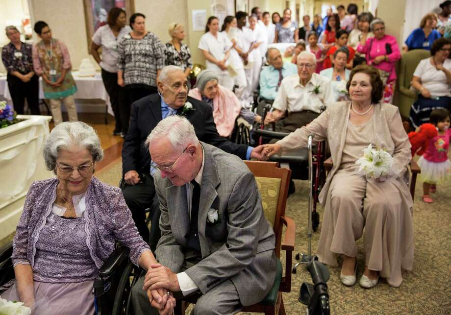 Angelina and Ronald Hoyt, who have been married for 55 years, hold hands during a wedding vow renewal ceremony for four senior couples at Morningside Ministries at the Manor in San Antonio, Texas on Tuesday, June 30, 2015. Photo: Carolyn Van Houten, Staff / San Antonio Express-News / 2015 San Antonio Express-News