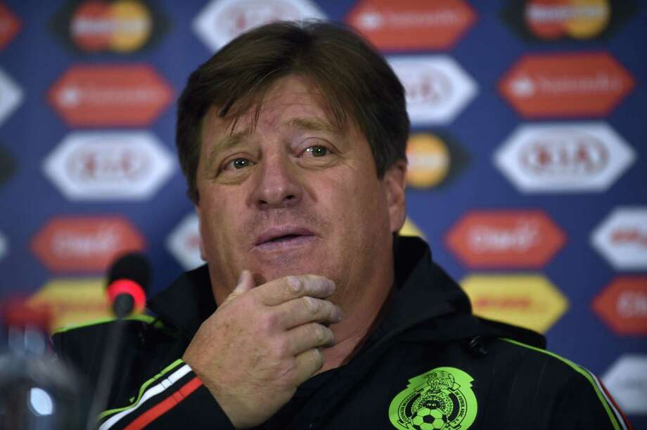 Mexico's coach Miguel Herrera gestures during a press conference held in the framework of the 2015 Copa America football championship, in Rancagua, Chile, on June 18, 2015.  AFP PHOTO / PABLO PORCIUNCULAPABLO PORCIUNCULA/AFP/Getty Images Photo: PABLO PORCIUNCULA, Staff / PABLO PORCIUNCULA