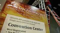 Workers put up signage on the convention floor on Tuesday, June 30, 2015, in preparation for the General Conference Session 2015 of the Seventh-day Adventist World Church at the Henry B. Gonzalez Convention Center.