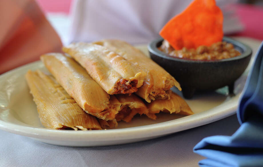 Jacala tamales served with chili. Photo: Kin Man Hui /San Antonio Express-News / San Antonio Express-News