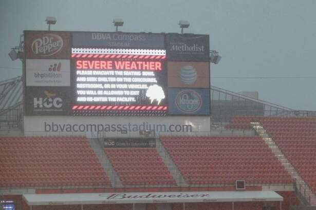 A severe weather warning on the big screen at BBVA Compass Stadium as rain falls Tuesday, June 30, 2015, in Houston.