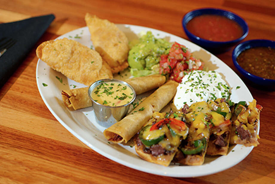 Tiago's Cabo Sampler has appetizers including chicken flautas, fire-grilled beef fajita nachos, chicken empanadas and chili con queso. Photo: Courtesy Tiago's Cabo Grille