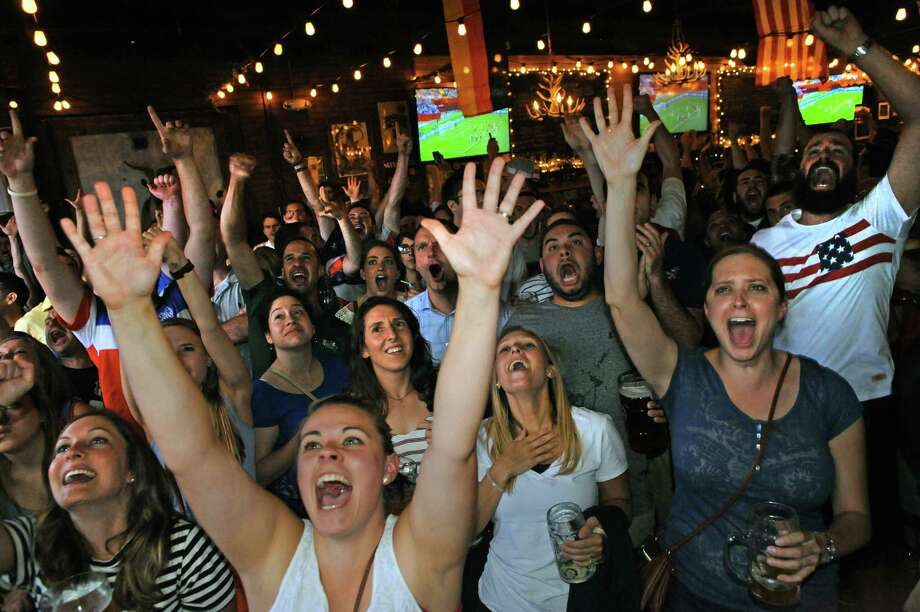 Soccer fans erupt while watching the USA vs. Germany in the World Cup semifinals at Wolff's Biergarten on Tuesday June 30, 2015 in Albany, N.Y.  (Michael P. Farrell/Times Union) Photo: Michael P. Farrell / 00032441A