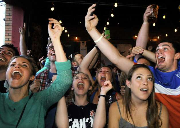 Soccer fans erupt while watching the USA vs. Germany in the World Cup semifinals at Wolff's Biergarten on Tuesday June 30, 2015 in Albany, N.Y.  The USA defeated Germany 2-0. (Michael P. Farrell/Times Union) Photo: Michael P. Farrell / 00032441A