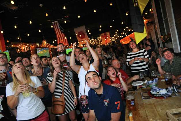 Soccer fans watch with earnest and eager attention during the USA vs. Germany Women's World Cup semifinals at Wolff's Biergarten on Tuesday June 30, 2015 in Albany, N.Y.  The USA defeated Germany 2-0. (Michael P. Farrell/Times Union) Photo: Michael P. Farrell / 00032441A