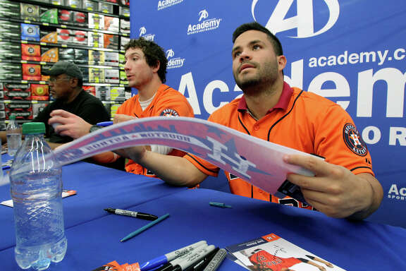 Houston Astros players Jose Altuve and Brett Wallace sign autographs with J.R. Richard and broadcaster Bill Brown at the Academy Sports and Outdoors store at 1604 near Gold Canyon on Jan. 24, 2013.