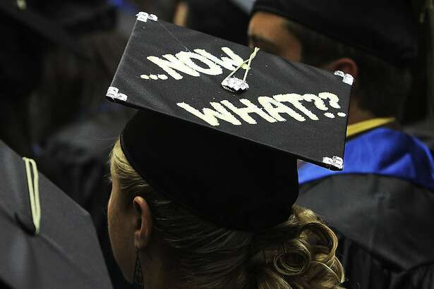 """A graduate's mortar board displays the often-asked question, """"Now What??"""" during UTSA's Spring commencement ceremonies for the College of Education and Human Development on Friday, May 6, 2011. Kin Man Hui/kmhui@express-news.net"""