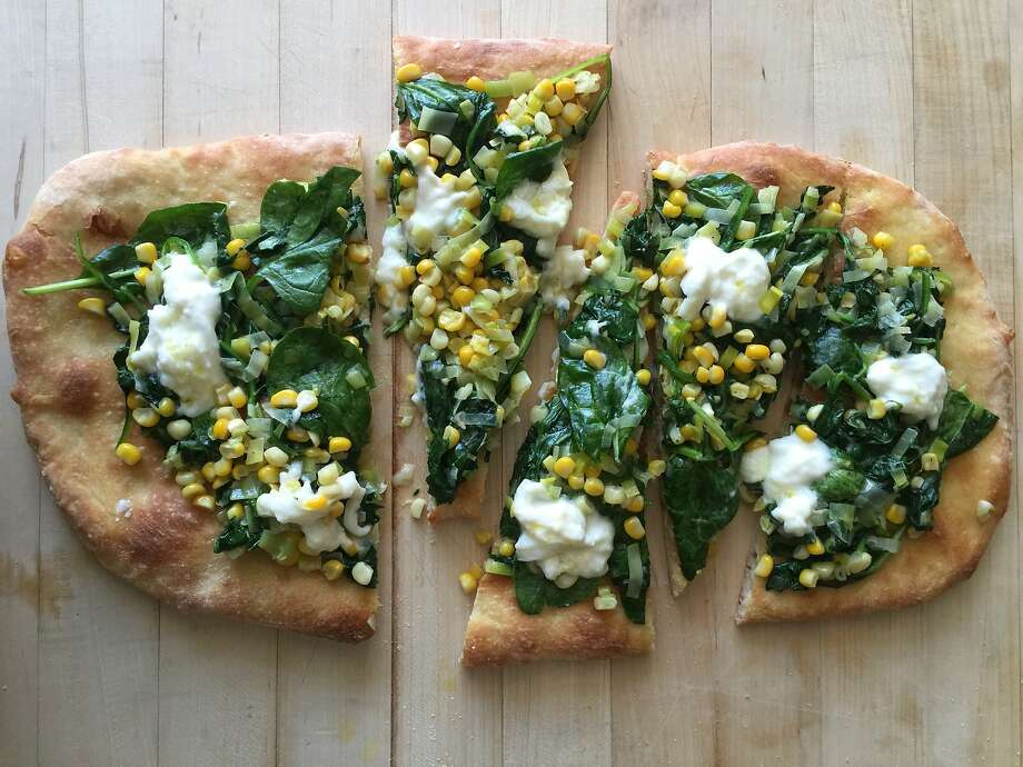 flatbread with spinach, corn and Burrata Photo: Amanda Gold