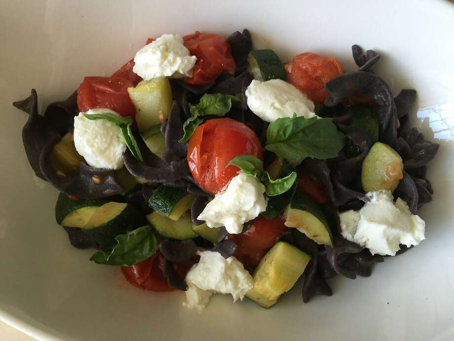 Black bean pasta with roasted tomatoes, zucchini and goat cheese Photo: Amanda Gold