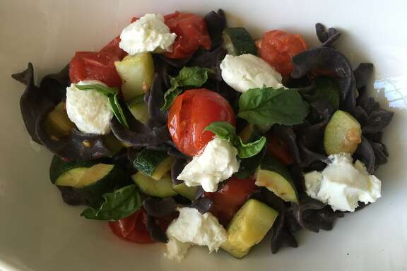 Black bean pasta with roasted tomatoes, zucchini and goat cheese