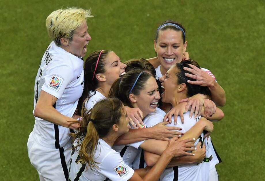 USA's midfielder and goal scorer Carli Lloyd (R) celebrates with teammates during their 2015 FIFA Women's World Cup semifinal match against Germany at Olympic Stadium in Montreal on June 30, 2015.    AFP PHOTO/NICHOLAS KAMMNICHOLAS KAMM/AFP/Getty Images Photo: NICHOLAS KAMM, Staff / AFP