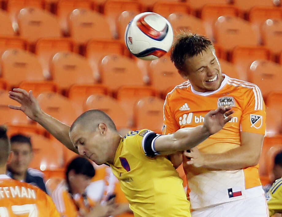 Colorado Rapids midfielder Sam Cronin left, and Houston Dynamo midfielder Zach Steinberger right, jump for a header during first half of the Open Cup game at BBVA Compass Stadium Tuesday, June 30, 2015, in Houston. Photo: James Nielsen, Houston Chronicle / © 2015  Houston Chronicle
