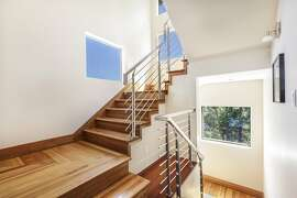 A turned staircase leads to the upper level of the Oakland home.