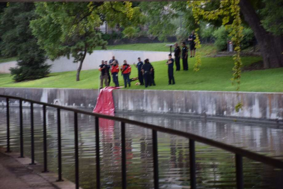 A person running along the San Antonio River Walk discovered a body floating in the water Wednesday morning July 1, 2015. Photo: By Mark D. Wilson/San Antonio Express-News