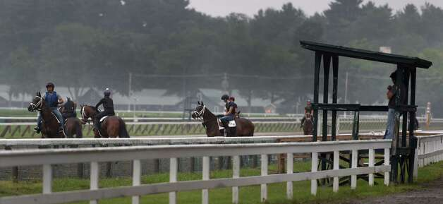 A set of Todd Pletcher trainees go out for their morning exercise on a muddy main track at Saratoga Race Coruse Wednesday morning, July 1, 2015, in Saratoga Springs, N.Y. (Skip Dickstein/Times Union) Photo: SKIP DICKSTEIN