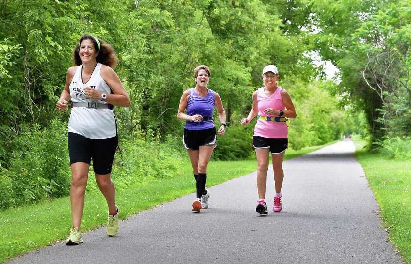 Out for their morning run along the bike path are, from left, Susan Huston of Troy, Valerie Pezzula