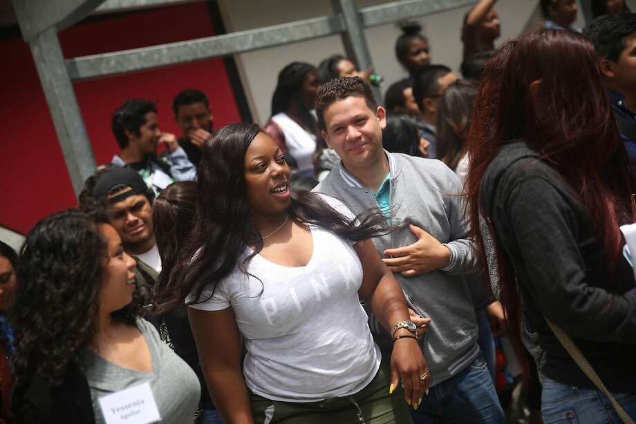 San Francisco State Student Kayla Jackson (center l to r) talks with Cesar Campos as they work with the Metro College Success Program team during Freshman Orientation at San Francisco State University on Tuesday, June 30, 2015 in San Francisco, Calif. Photo: Lea Suzuki, The Chronicle