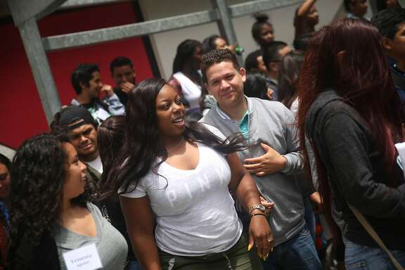 San Francisco State Student Kayla Jackson (center l to r) talks with Cesar Campos as they work with the Metro College Success Program team during Freshman Orientation at San Francisco State University on Tuesday, June 30, 2015 in San Francisco, Calif.