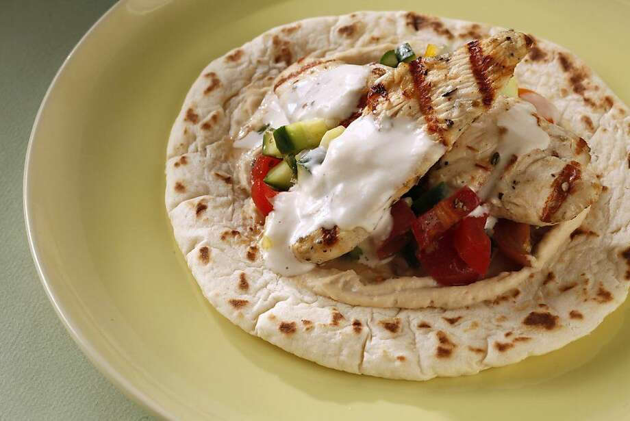 Greek Chicken Flatbread Sandwich as featured in The Weeknight Dish by Amanda Gold. Photo: Craig Lee /Special To The Chronicle