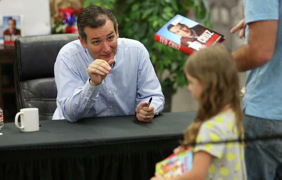 """Sen. Ted Cruz smiles and waves at Brooklyn de Santos who is with her father Carlos De Santos during a book signing of Sen. Ted Cruz new book """"A Time For Truth"""" at Sam's Club on Wednesday, July 1, 2015, in Houston. Photo: Mayra Beltran, Houston Chronicle / © 2015 Houston Chronicle"""