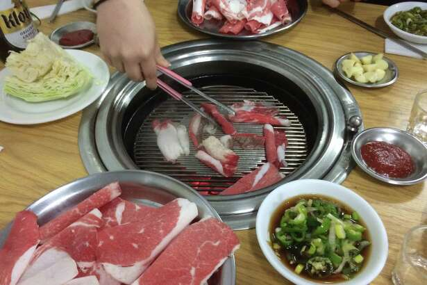 Cooking brisket at a traditional Korean barbecue restaurant in the Noksapyeong neighborhood in Seoul, Korea.