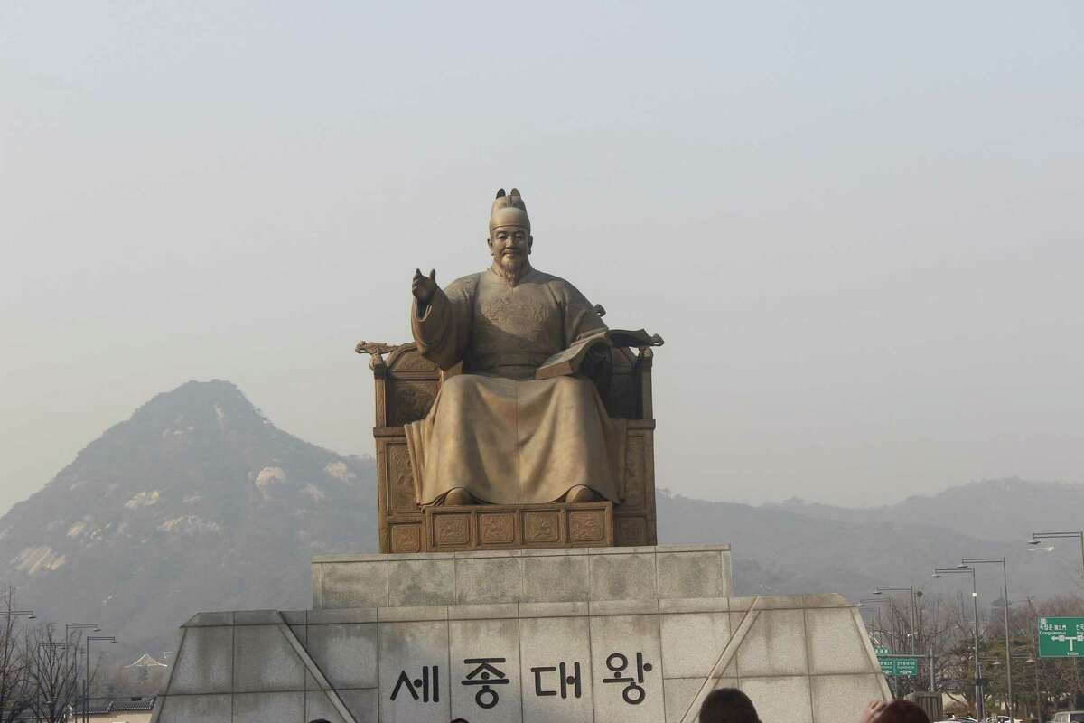 A statue of Sejong, the fourth king of the Joseon Dynasty of Korea, in front of the Gyeongbok Palace.