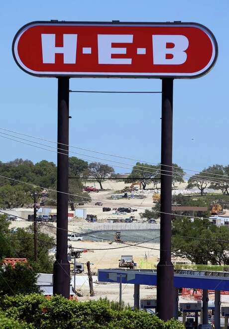 A Walmart construction site near the intersection of U.S. 281 and Hwy 46 is seen Thursday, April 30, 2015 through the sign for a nearby HEB. Photo: William Luther, Staff / San Antonio Express-News / © 2015 San Antonio Express-News