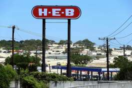 A Walmart construction site near the intersection of U.S. 281 and Hwy 46 is seen Thursday, April 30, 2015 through the sign for a nearby HEB.
