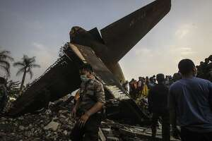 Indonesia plane crash death toll 141 as search effort ends - Photo