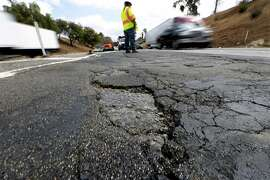 Caltrans Maintenance Supervisor Howard Mead stands near the Los Angeles junction of the I-5 Southbound and the Eastbound 60, where there are numerous potholes and examples of the roadway cracking. After years of neglect, state officials estimate it will cost $59 billion to fix the now-crumbling roads and freeways. (