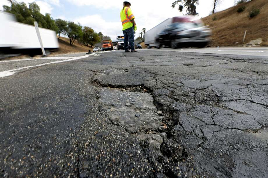 A Caltrans supervisor stands near the pothole-pocked Los Angeles junction of the I-5 Southbound and the Eastbound 60. Photo: Mark Boster, McClatchy-Tribune News Service