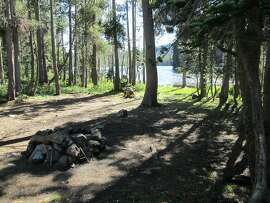 On a trip to Lakes Basin Recreation Area, located along Gold Lake Road between Bassetts on Highway 49 and Graegle on Highway 89, this empty campsite at Snag Lake awaited 4th of July vacationers