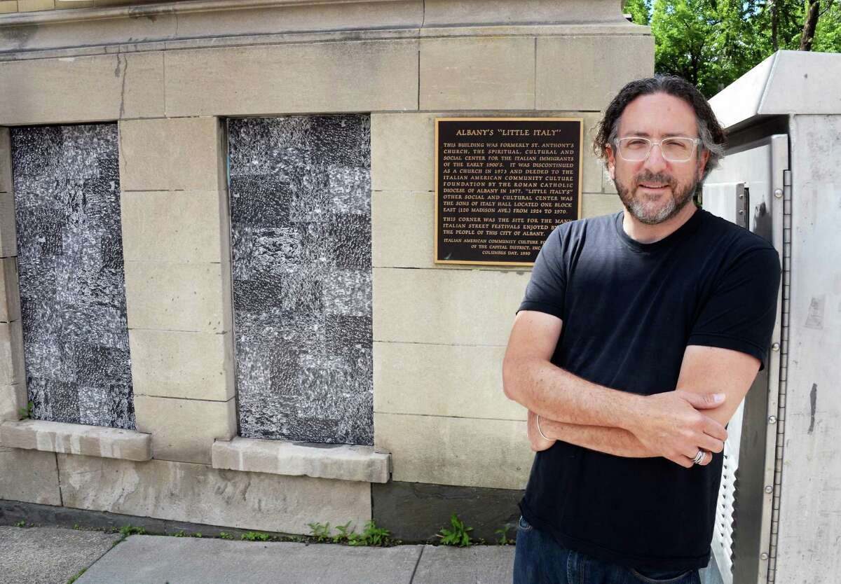 """Artist Thomas Lail beside two of his 11 cut xerographic panels """"Crowd"""", at the former St. Anthony's Church along Madison Ave. Wednesday June 24, 2015 in Albany, NY. (John Carl D'Annibale / Times Union)"""