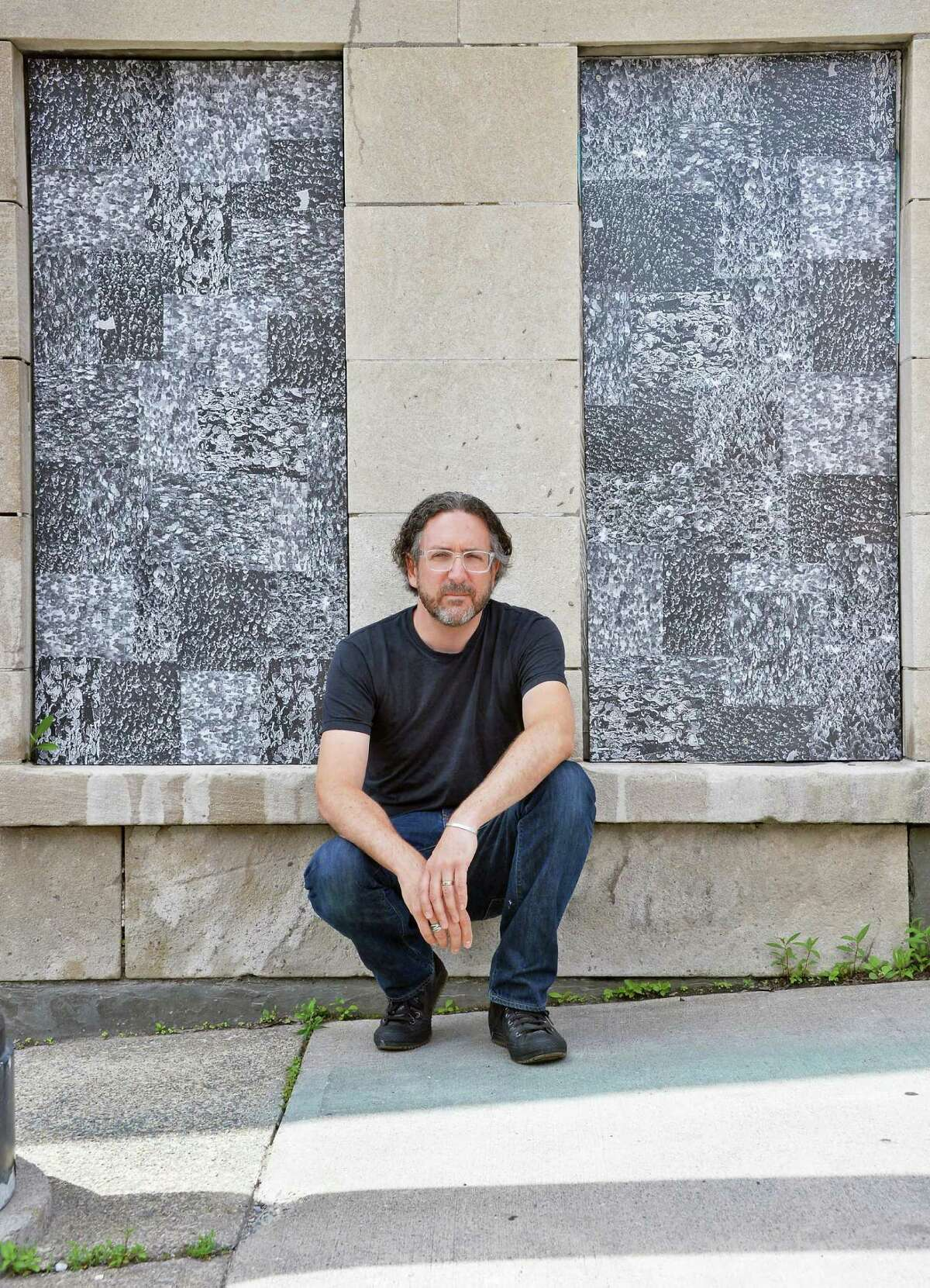 Artist Thomas Lail beside two of his 11 cut xerographic panels