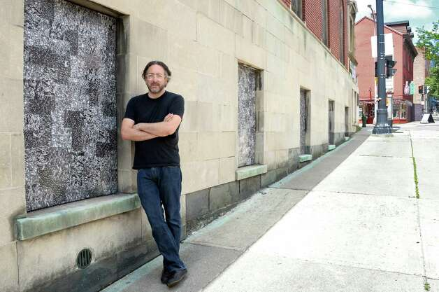 """Artist Thomas Lail beside his 11 cut xerographic panels """"Crowd"""", at the former St. Anthony's Church along Madison Ave. Wednesday June 24, 2015 in Albany, NY.  (John Carl D'Annibale / Times Union) Photo: John Carl D'Annibale / 00032358A"""