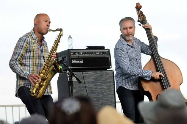 Saxophonist Joshua Redman, left, and bassist Reid Anderson perform with The Bad Plus during Alive at Five on Thursday, June 11, 2015, at Jennings Landing in Albany, N.Y. (Cindy Schultz / Times Union) Photo: Cindy Schultz / 00032223A