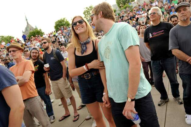 Elizabeth Nelson, center, and her boyfriend Sam Beatt, both of Pittsburgh, listen to The Bad Plus Joshua Redman during Alive at Five on Thursday, June 11, 2015, at Jennings Landing in Albany, N.Y. The couple is on a music tour, including many free concerts, as they make their way to Burlington, Vt. (Cindy Schultz / Times Union) Photo: Cindy Schultz / 00032223A