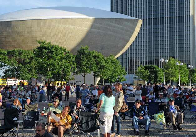 A crowd fills in the grounds as the band Orleans plays as part of the opening night of the Plaza Concert Series at the Empire State Plaza on Wednesday June 3, 2015 in Albany , N.Y.  (Michael P. Farrell/Times Union) Photo: Michael P. Farrell / 10032072A