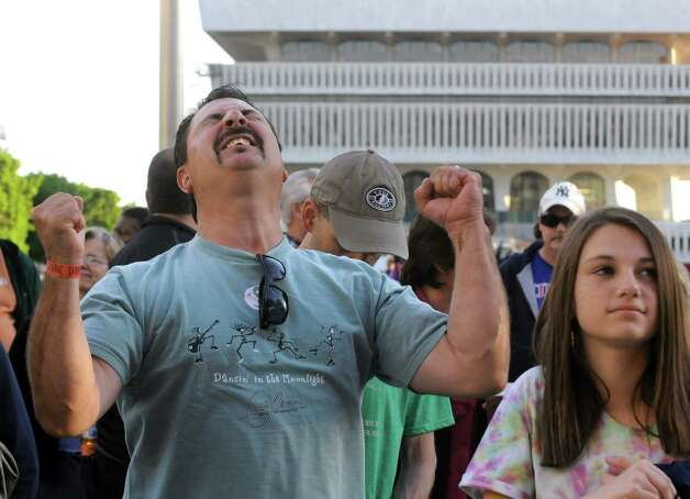 Mike Leonard of Saratoga Springs reacts as the band Orleans plays as part of the opening night of the Plaza Concert Series at the Empire State Plaza on Wednesday June 3, 2015 in Albany , N.Y.  (Michael P. Farrell/Times Union) Photo: Michael P. Farrell / 10032072A