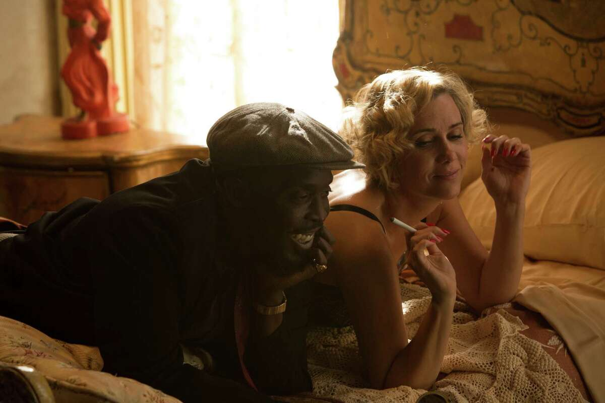 Kristen Wiig plays singer Dolores De Winter, with Michael Kenneth Williams as jazz piano player Rock Banyon.