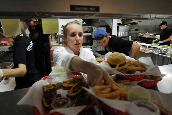 Katrina Leal, the food and beverege director of the Alamo Drafthouse Stone Oak, works in the bustling kitchen.
